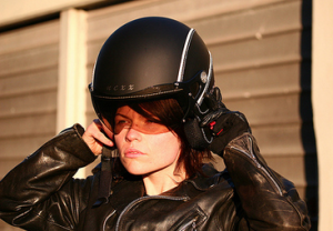 Nexx X60 Vintage Helmet being put on by Woman biker