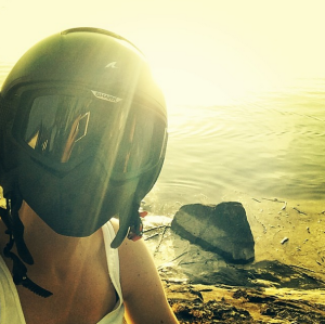sunset photo of female biker wearing shark raw helmet