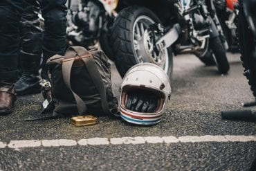 classic helmet next to a bike