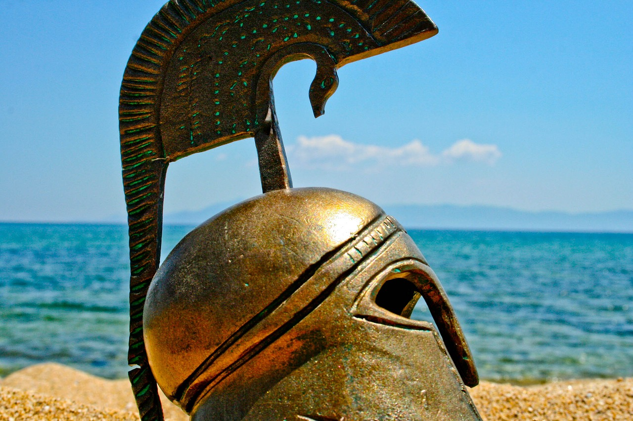 A helmet sitting on a beach