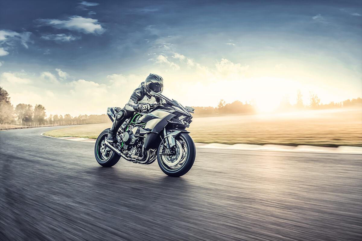 2021 Kawasaki Ninja H2R at speed with sunset background