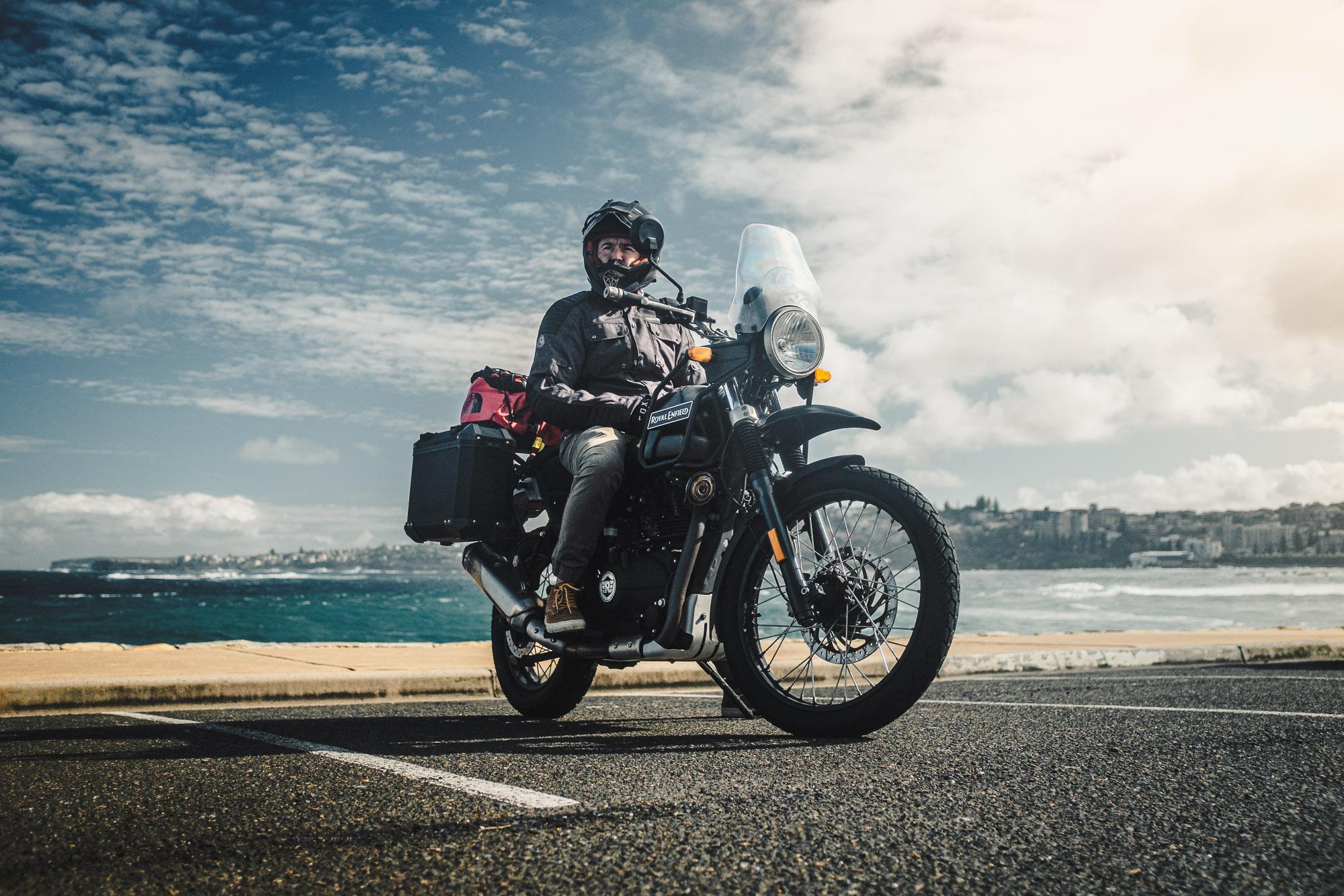 Daniel 'Beardy' McLaughlin on a Royal Enfield Himalayan at Bondi Beach