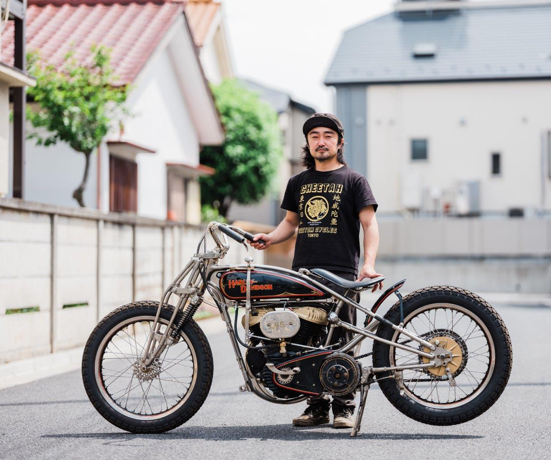Custom Harley-Davidson motorcycle with builder on Tokyo street