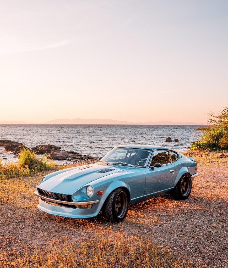 Datsun 240Z on a beach at sunset in Southern Japan