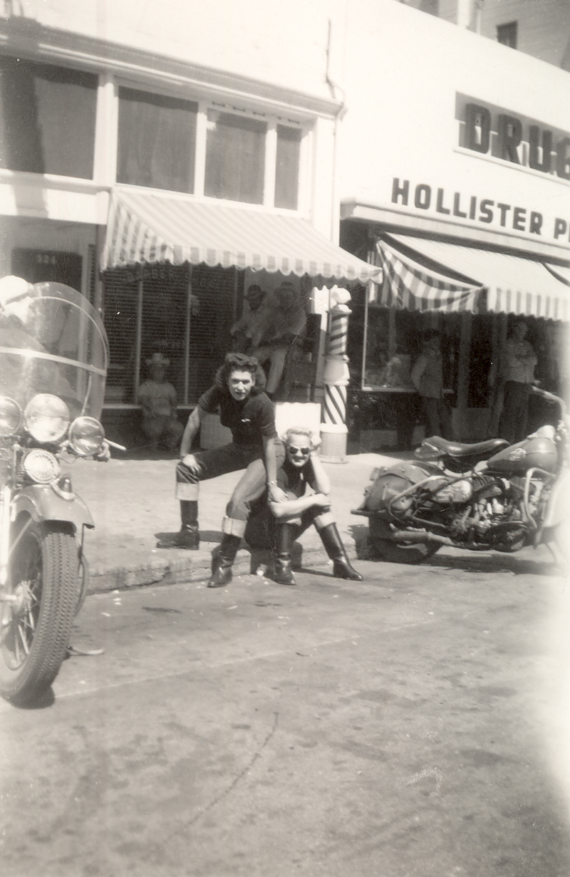 Two members of the Tracy Gear Jammers sitting on a Hollister, CA. street corner in July, 1947