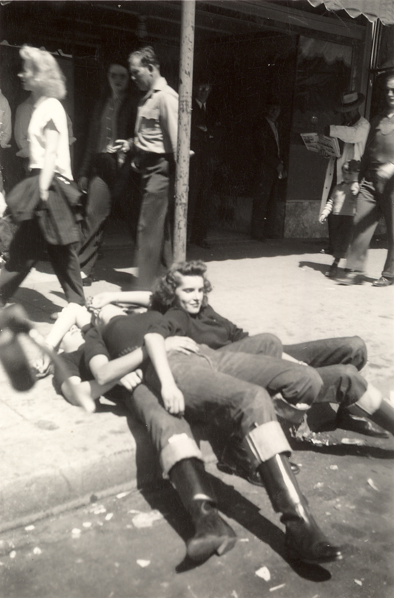 Three members of the Tracy Gear Jammers sitting on a Hollister, CA. street corner in July, 1947