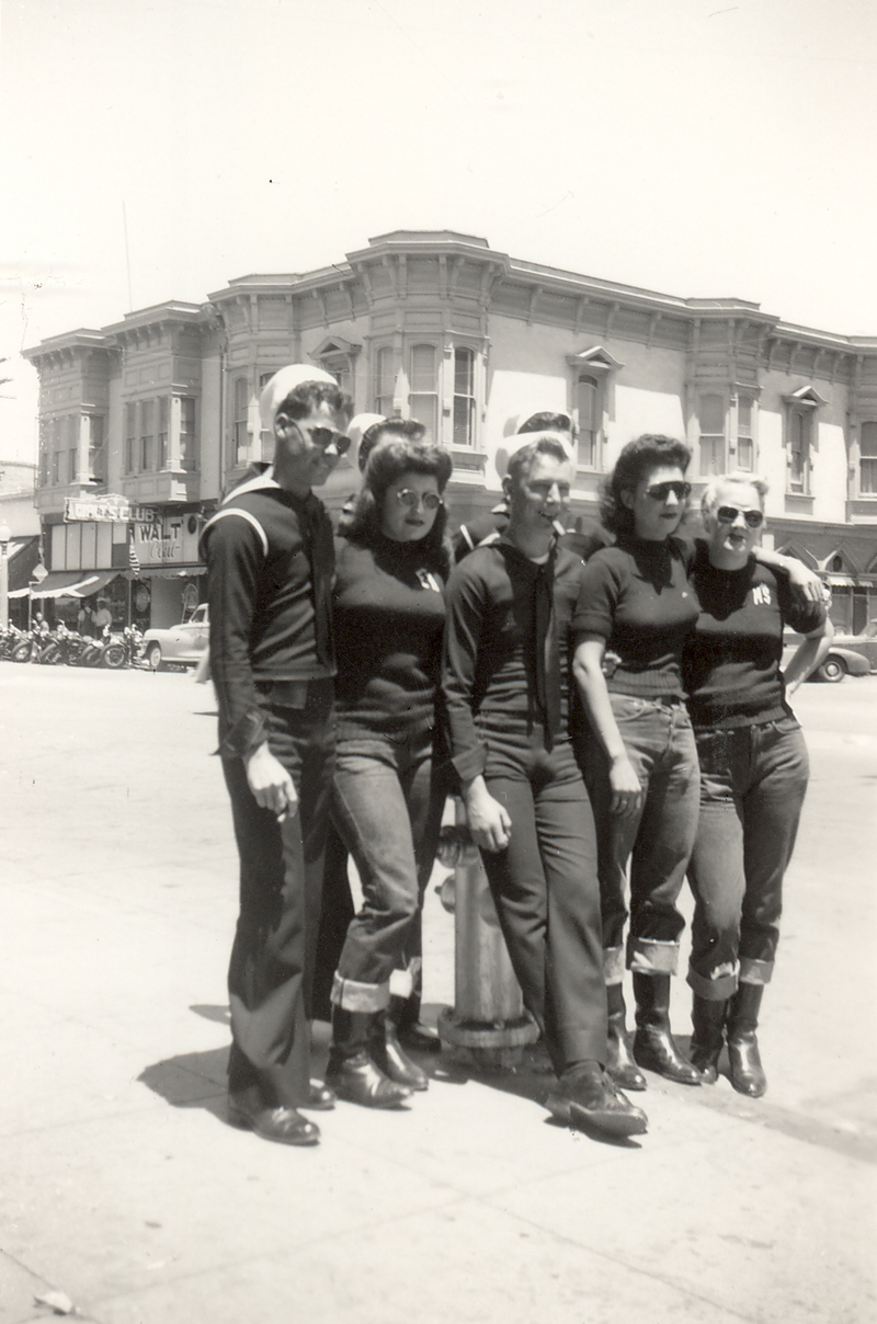 Male sailors pose with female members of the Tracy Gear Jammers on a Hollister, CA. street corner in July, 1947