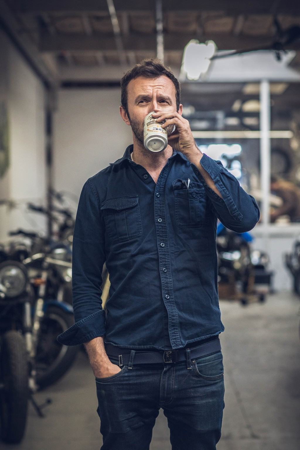 Hugo Eccles from San Francisco's Untitled Motorcycles with a beer