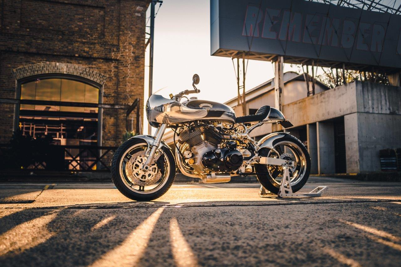 A custom Vincent Black Shadow motorcycle at dusk by MotorRetro Sydney