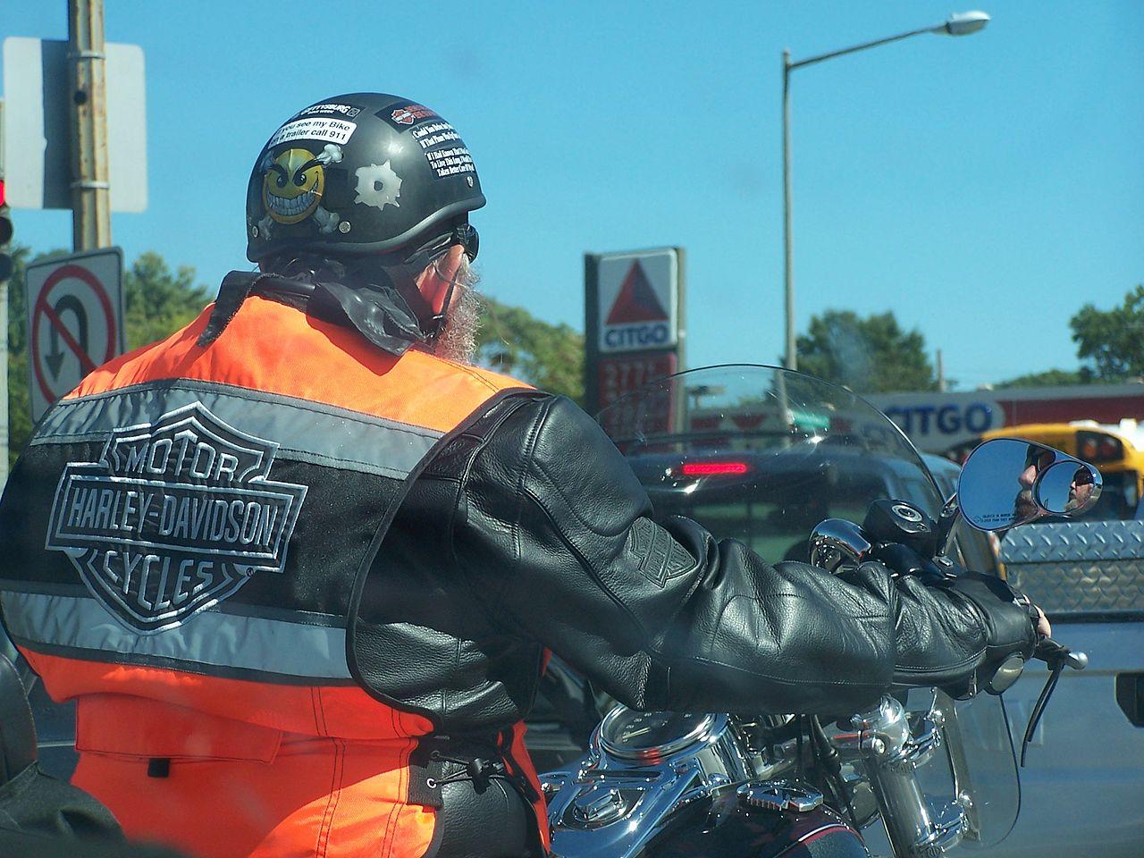 Rider on motorcycle wearing Harley vest