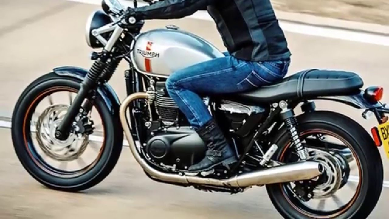 Triumph Motorcycle being ridden on a road