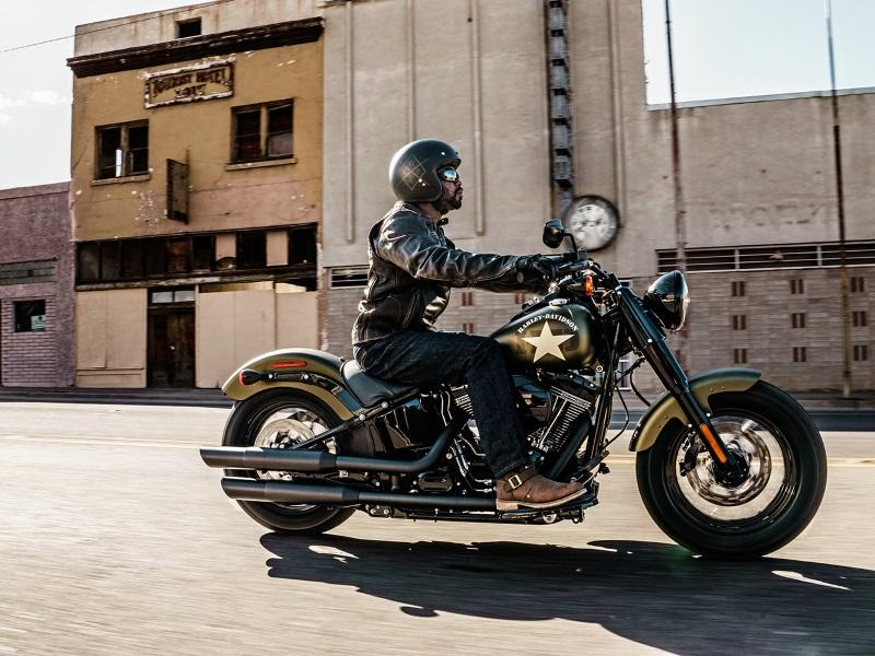 Harley rider wearing a three quarters helmet