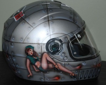 Motorcycle helmets with naked women art